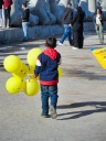 Young boy selling balloons